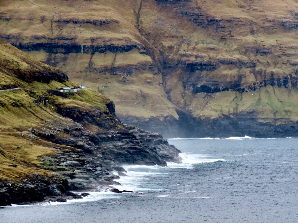 The faroe islands are surrounded by breathtaking cliffs